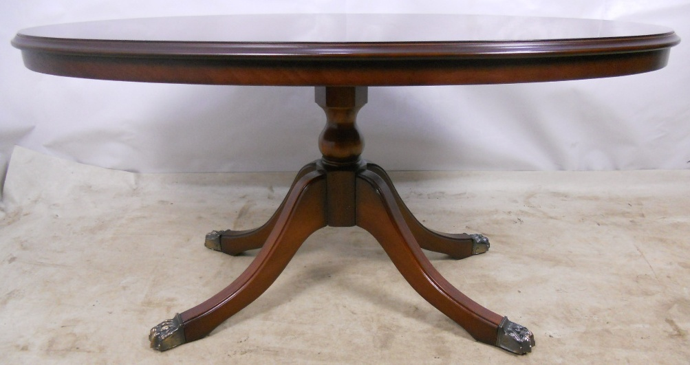 Oval Pedestal Coffee Table