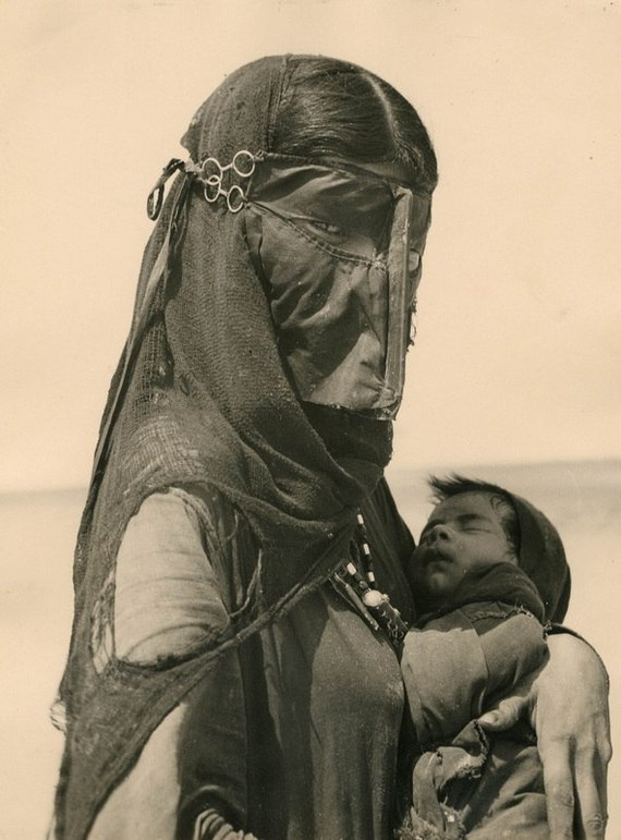 Mother with her son. Bedouin Arabs. Kingdom of Egypt. 1949.