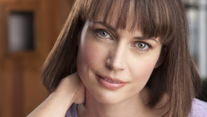 Julie Ann Emery Background